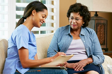 Caregiver Taking Notes